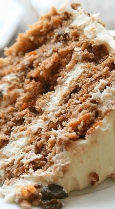 Southern Style Carrot Cake ~ This cake consists of three moist layers that are full of sweet carrots and raisins. In between those layers is a lightly sweetened cream cheese frosting and chopped pecans.
