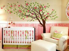 Inspired by the bumper fabric, designer Joanna Gick of J&J Design Group uses bold pinks and greens to create her daughter's whimsical nursery. Below the chair rail, she painted the wall pearl white and applied a dark pink glaze in a faux bois pattern. Photography by John Woodcock