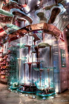 At 27-feet tall, this chocolate fountain by Jean-Philippe Maury is the world's largest, located inside the Bellagio, Las Vegas. Not just eye candy, this fully-functional chocolate fountain circulates a whopping 2100-pounds, at the rate of 120 quarts per minute.