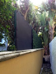 Noise control required along shelly beach road fence. Acoustifence noise barrier installed at the residential property line quiets noise coming from neighbors. Artificial Ivy was used to conceal the Acoustifence and provide a more natural look. Outdoor Walls, Outdoor Living, Jacuzzi Outdoor, Ranch Style Homes, Noise Reduction, Sound Proofing, Back Gardens, Outdoor Projects, Backyard Landscaping
