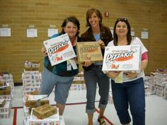 Sage Creek Elementary's PTA president, Diana Harmon,fundraising chair, Brenda Suckow and president elect, Valori Tanner show off a few of the hundreds of pizza orders they received from their Little Caesar's fundraiser campaign. All the money generated from this fundraiser goes toward purchasing educational materials that will benefit the students at Sage Creek.
