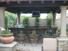 Traditional Outdoor Kitchen in Clovis - cinder block privacy walls, counter mount grill | by Exterior Details