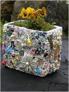 Kitschy Sparkle Planter from Faith Schuster. Make your own to suit you taste using old jewelry (or broken china!) - adhere items with liquid nails, grout, plant & enjoy!