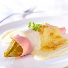 What makes Belgian cuisine so special? Surprise your senses with this Belgian recipe: endives with grilled cheese, so yummy!!! http://visitbrussels.be/bitc/BE_en/brusselicious_recipe/18554/belgian-endive-rolls-in-a-cheese-sauce-chicons-au-gratin.do