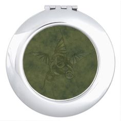 Dragon Star - Embossed Green Leather Image Makeup Mirror  Dragon Star - Embossed Green Leather Image Makeup Mirror    $17.75  by  Tannaidhe  http://www.zazzle.com/dragon_star_embossed_green_leather_image_makeup_mirror-256493602915423206    - - - Take a look at lots more designs at my Z-store!  http://www.zazzle.com/tannaidhe?rf=238565296412952401&tc=MPPin