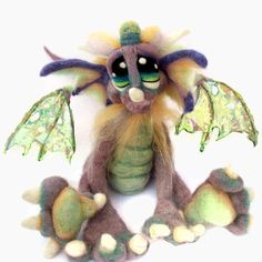 This artist is AMAZING! And, understandably backed up with orders over six months!  Etsy listing at https://www.etsy.com/listing/55232020/made-to-order-ooak-needle-felted-magical