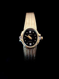 Ladies Gold Tone Watch.  $25