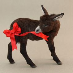 """""""Merry Mischief"""" Dollhouse Miniature Donkey The epitome of what makes a sassy longear so endearing... This 1:12 scale Donkey was hand-sculpted in a static 'turning-to-the-right' pose from polymer clay over wire reinforcement, acrylic paint, and dressed in a shaggy coat of cocoa brown & black alpaca and powder-fineflocking. A one-of-a-kind sculpture created to 'bring to life' a variety of miniature settings, or displayed as a stand-alone piece of original miniature art."""