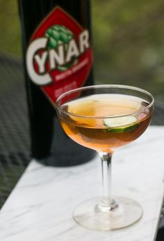 A bracing cocktail featuring gin, Cynar, vermouth along with cucumber - a sophisticated libation!