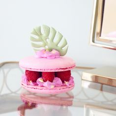 Raspberry Macaron Sandwich topped with an edible Jungle Leaf