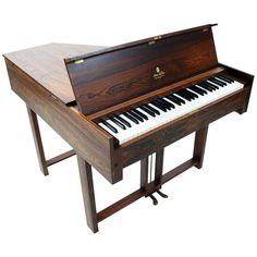 Rare Steen Nielsen Rosewood Hammerspinet   From a unique collection of antique and modern musical instruments at https://www.1stdibs.com/furniture/more-furniture-collectibles/musical-instruments/