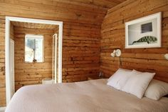 modernize wood paneling with white moulding and a fabulous headboard photo