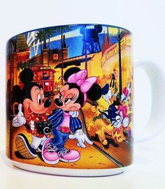 Vintage 1987 - Japan  Disney Mickey Mouse & Minnie Mouse Mug   In it's original box  Beautiful vibrant color graphics of Mickey and Minnie at MGM Studios!  Mug features:  Mickey mouse ears water tower Mickey Mouse in a Hawaiian shirt as a Disney Park Guest Minnie Mouse Donald Duck  Daisy  Goofy Pluto Mad Hatter the White Rabbit Chip & Dale Alice in Wonderland And a street car named Desire
