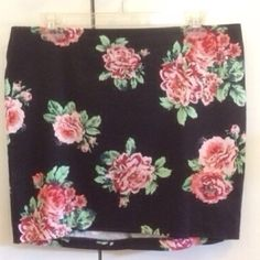 Floral mini Black bodycon mini skirt with pink roses and zipper in the back. Dress up with a cute top and statement necklace or down with your favorite band tee and chucks. Forever 21 Skirts Mini