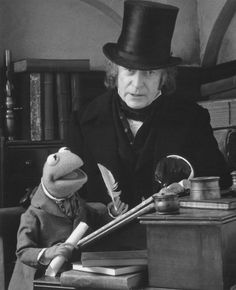 British actor Michael Caine stars as Ebenezer Scrooge, and the Muppet character Kermit the Frog as Bob Cratchit in the film, 'The Muppet Christmas Carol', Dec. Best Christmas Movies, Christmas Shows, Christmas Past, A Christmas Story, Christmas Carol, Muppets Christmas, Holiday Movies, Xmas Movies, Cosy Christmas