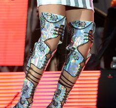 Rita Ora Is Iridescent in Holographic Top, Skirt, and Thigh-High Boots