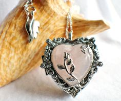 Music box locket,  heart shaped locket with music box inside, in silver tone with pink crystal heart and silver accents.