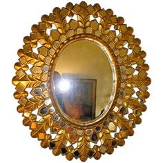 Carved and Gilt Oval Sunburst Mirror | From a unique collection of antique and modern sunburst mirrors at https://www.1stdibs.com/furniture/mirrors/sunburst-mirrors/