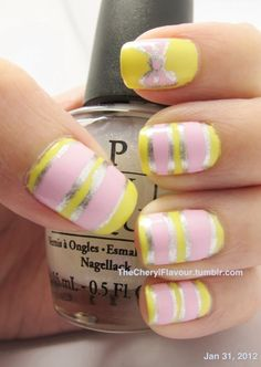 yellow, silver and baby pink stripes with a bow accent nail!