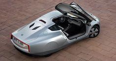 Volkswagen ••XL1•• open back 3/4 top (1) (via VWVortex) •world's most fuel-efficient car ever - 1st real concept car ; ) as most are just teasers for internal use, always dulled down, only briefly inspiring but ultimately frustrating w/ practicality • dev 2002 • 2-seater • 1753 lbs (< 1/2 Ford Fusion) • drag coefficient .186 vs audi A5 .31 or H2 .57! • choice: hybrid or diesel • 2c 800cc • 100km/1L or 240mpg! • EU 1st, only 400 cars?! 2016 in USA? • big neg: $140k beats saving if not rich!