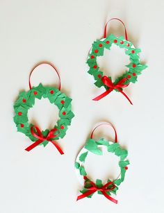Here's a homemade Christmas ornament perfect for toddlers and preschoolers- tear art Christmas wreaths! This Christmas craft for kids is super easy to make and looks adorable hanging up on the Christmas tree!