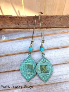 Green patina Morocan drops with blue coconut bead earrings. McKee Jewelry Designs