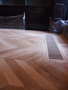 Integrated heating in Chevron parquet by Atelier des Granges