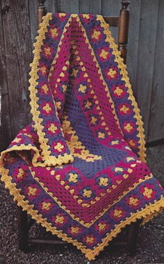 The colors and the border on this crochet granny square afghan are amazing