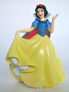 "Looks like Snow White is getting ready to dance. But which dwarf will she chose? SNOW WHITE PVC FIGURE (2013) (from Walt Disney's ""Snow White and the Seven Dwarfs"")"