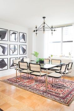[New] The 10 All-Time Best Home Decor (Right Now) - Ideas by Trena Pino - In the dining area of a Manhattan apartment by a set of cane chairs surrounds a glass-topped table. A Persian rug and a set of framed abstract prints complete the space. Photo by Dining Room Inspiration, Interior Inspiration, Design Inspiration, Dining Room Design, Dining Area, Dining Table, Small Dining, Dining Rooms, Dinner Room