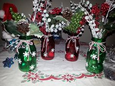 Christmas decorations-mini glass milk jars, frosted colored jingles bells for inside, winter picks, snowflake confetti, hot glue gun, colorful yarn