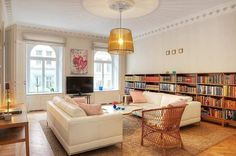 white sofas, bookcased walls, light- client/sitting room