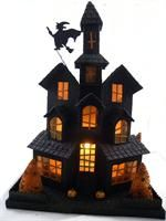 """Black Glittered Halloween House ~  Pressed cardboard embellished with glitter, bottle brush trees, witch on a broom, and pumpkins. Light cord included. 13"""" L x 9"""" W x 18"""" H ~ KD Vintage."""