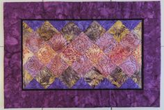 Set of Four Handcrafted quilted batik by Quiltsbysuewaldrep