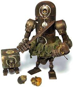 Dirty deeds Bertie MK 2 by Ashley Wood from threeA. Scrap Recycling, Steampunk Robots, Arte Robot, Retro Robot, Ashley Wood, Game Character Design, Robot Design, Assemblage Art, Vinyl Toys