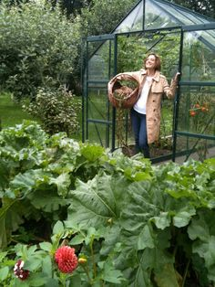 Ann in her greenhouse.