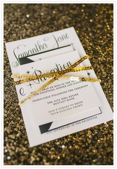 Love this black and white wedding invite wrapped in gold sequin