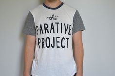 The Wordmark (navy/grey)  THE PARATIVE PROJECT exists to raise awareness on social injustice through conversational shirts about this issue. The goal behind every shirt is to serve as a conversation starter allowing you to share with others what is happening around the world. With every purchase, proceeds will be given to an organization that's fighting against the issue of human trafficking.  Join The Parative Project and start your own conversation.