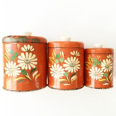 Vintage hand painted canisters add so much character to a kitchen! Discover more fantastic vintage finds at whattheseoldthings.com and whattheseoldthings.etsy.com! #vintage #vintagestyle #vintagehomedecor #vintagedecor #homedecorinspo #designinspo #vintagekitchen #vintagecanisters #orange