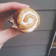 A baked cinnamon roll quest bar filled with a mixture of Greek yogurt, cinnamon, honey & melted peanut butter then rolled