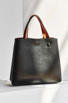 042261bf0d24 Urban Outfitters Mini Reversible Faux Leather Tote Bag - Black + Tan One  Size