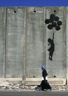 Banksy. Graffiti Mural on the Wall in Palestine>>>>> that would be even cooler if the little girl and the balloons were in color and there were ppl below in black and white