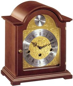 """22511-030340 - Hermle Bethnal Mantel Clock -  Bracket clock made of select hardwoods with walnut finish. Etched dial. The 8-day windup movement plays 4/4 Westminster chimes. the beautiful engraved brass dial has a silver color chapter ring with Roman numerals and serpentine hands.  Measures: H 11"""" x W 9"""" x D 6""""   Made in Germany - Three year warranty    Free shipping from http://www.theisenclock.com/mantel_clock.html"""