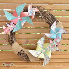 Create fun paper pinwheels for a gorgeous wreath!  (This post also shows you step-by-step how to quickly & easily make pinwheels in all sizes.)