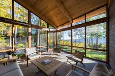 This modern mountainside home was designed by Mathison Mathison Architects, located in Great Barrington, Massachusetts. House With Porch, House In The Woods, Modern Wood House, Cedar Walls, Natural Stone Flooring, Building A Porch, Clerestory Windows, Screened In Porch, Large Windows