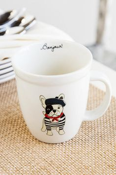 "Bonjour! Drink your morning coffee or tea in this cute & funny mug – decorated with an adorable frenchie in a black beret! <br /> <br /> - 4.25"" height<br /> - Dishwasher and microwave safe<br /> - By Natural Life<br /> - Imported<br /> <br />"