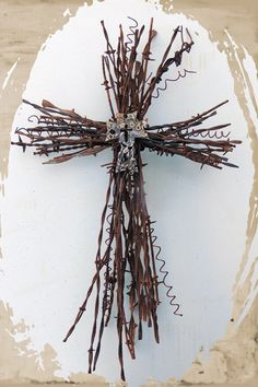 I made a simple cross by tying two bundles of sticks together to make a cross. I also share why I celebrate Easter each and every year. How to Make a Rustic Cross Using Sticks and Twine Barb Wire Crafts, Twig Crafts, Cross Crafts, Crafts To Make, Wire Crosses, Wooden Crosses, Crosses Decor, Easter Crafts, Christmas Crafts