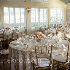 Champagne linens and gold chiavari chairs made the perfect backdrop for the coral flowers.