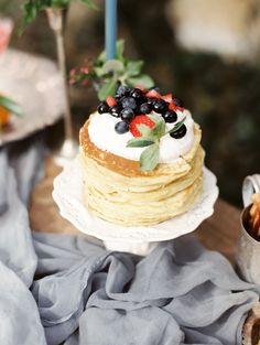 Newlywed breakfast pancakes with whipped cream blueberries and strawberries: http://www.stylemepretty.com/2016/09/04/inspiration-for-your-newlywed-life/ Photography: Morning Light by Michelle Landreau - http://www.mlbyml.com/