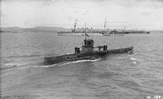 BRITISH SHIPS FIRST WORLD WAR (SP 527)   HM Submarine E.11 with the light cruiser HMS LOWESTOFT in the background.